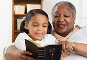 image - Grandma reading Bible to child