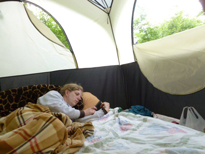 Anne hiding with her Kindle in the tent