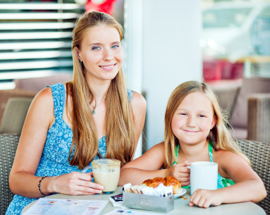 image - Mom and daughter having coffee together