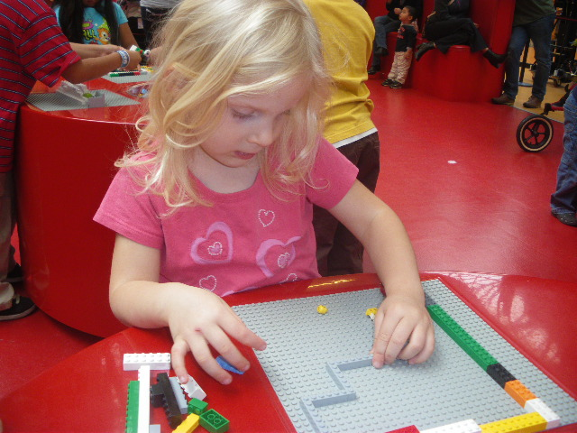 image - girl playing Legos