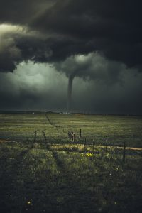 Tornado and Dark Storm Clouds in the Distance