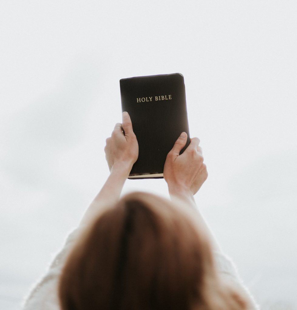 woman holding her Bible