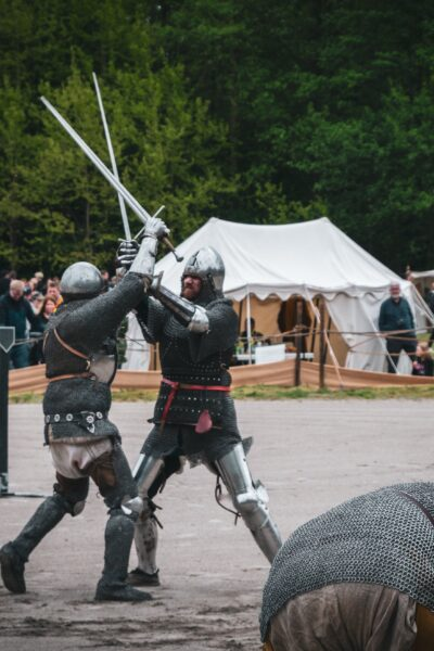 two soldiers fighting with swords