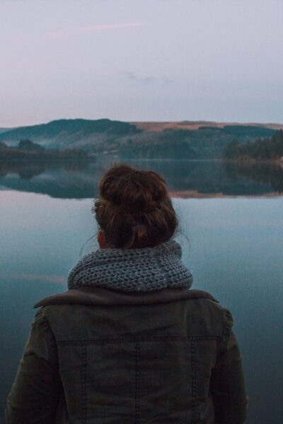 Woman silently looking at a lake
